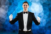 Portrait of happy music conductor holding baton against colored background poster
