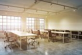 Workplaces in a bright sunset loft open space office. Empty tables and docents' book shelves. New York panoramic view. A concept of a high quality consulting services. Toned image. 3D rendering. poster