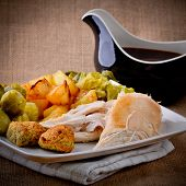 Chicken Sunday lunch with gravy boat vegetables potatoes and sprouts poster