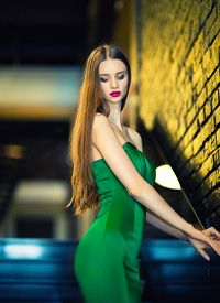 Woman In Green Dress Going Down By Stairs