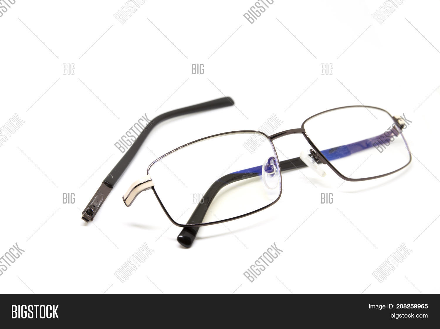 172622c01b Broken glasses on white background. Eye glasseswith thin metal rim after  accident. Computer glasses