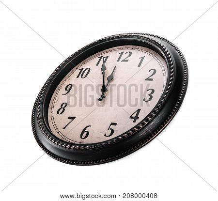 Ancient wall clock on a white background. Without five midnight on the clock. Side view.