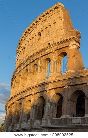 Ancient Colosseum at sunset in Rome, Italy