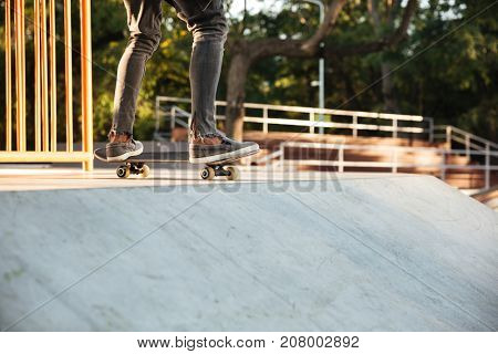 Close up of a young teenage skateboarder in action on a ramp
