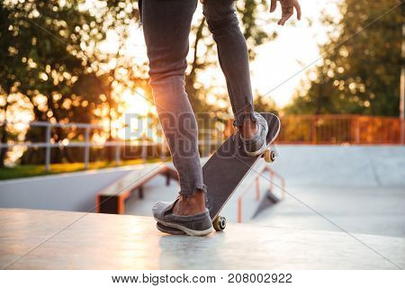Cropped image of a skater boy practicing at the skate park
