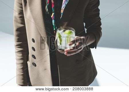 Person Holding Glass With Gin Tonic