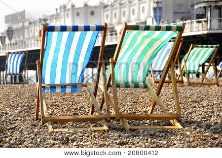 Deck Chairs By The Pier