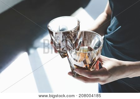 Person Holding Glasses Of Cognac