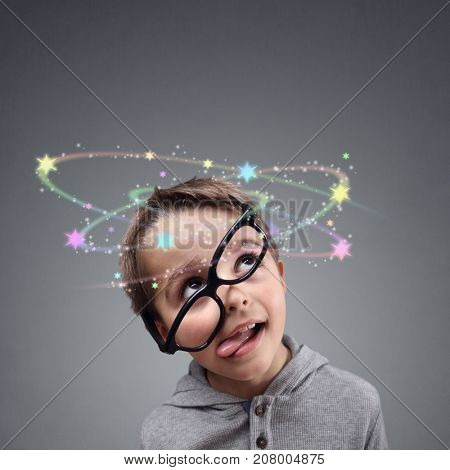 Confused thinking or knocked out boy seeing spinning stars above head