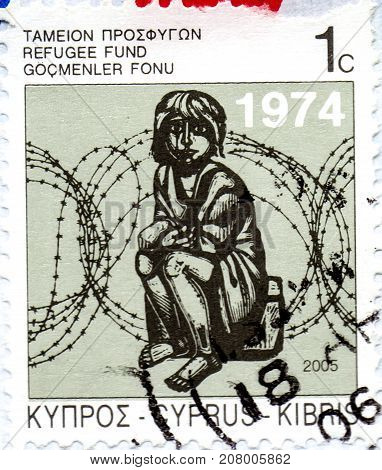 Ukraine - circa 2017: A postage stamp printed in Cyprus shows child and an inscription Obligatory Refugee Fund Tax circa 2006