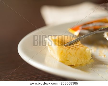 Fork stab on piece of pancake dessert. Diet and healthy concept.