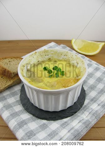 Fine ragout with roasted bread and lemon