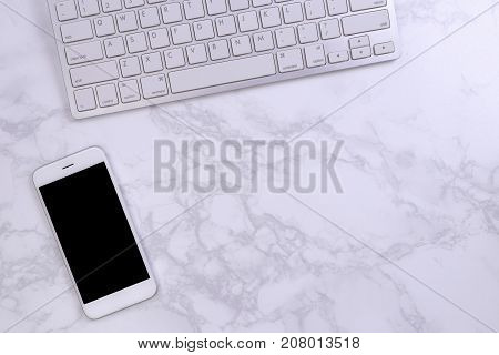 Mockup smartphon with keyboard on marble background