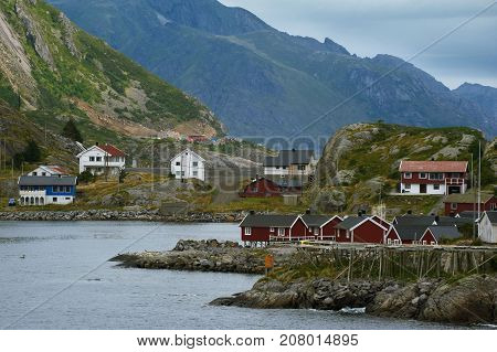 Small village at the water and mountains on background Lofotens Norway