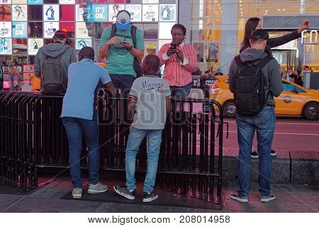 New York City, Usa, September 10, 2017 : Young People Gather In Times Square. Times Square Is A Majo