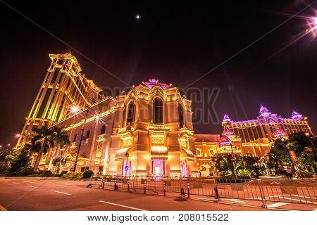 Macau, China - December 8, 2016: shining Galaxy Macau Casino hotel in Cotai Strip, during the laser show. Macao typical street scene of nightlife.
