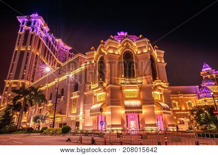 Macau, China - December 8, 2016: shining laser show at night at Galaxy Casino and hotel in Cotai Strip of Macau. Typical street scene of nightlife and entertainment.