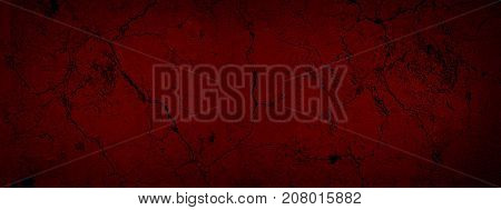 Red dark old background with cracked paint. Red black vignetted blank aged background. Long format. Cracked texture.