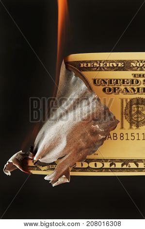 US money currency set on fire concept.