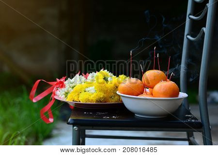 the pay respect ceremony with bunch of flowers and fruits