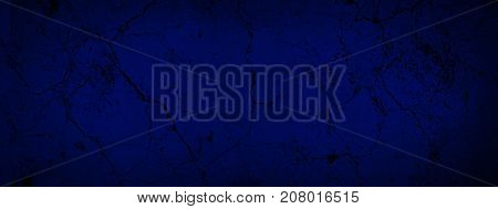 Blue dark old background with cracked paint. Blue black vignetted blank aged background. Long format. Cracked texture.