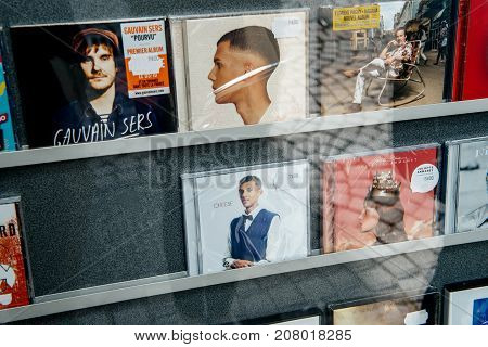 STRASBOURG; FRANCE - OCT 1; 2017: Music record store with audio CD of Stromae; Florent Pagny singer on the shelf