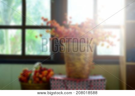 The Blurred Of Red ,yellow And Pink Flowers In Basket Near The Window