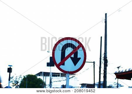 the sign of no u-turn on the road in the city