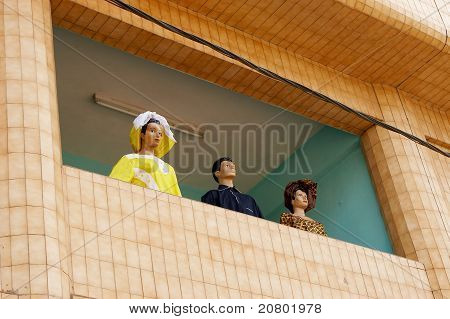 Three mannequins in a store window in Africa
