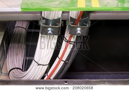 Closeup Of Cables In Clamps. Grounding Conductor, Earth Lead, Ground Lead With Dust Neutral Conducto