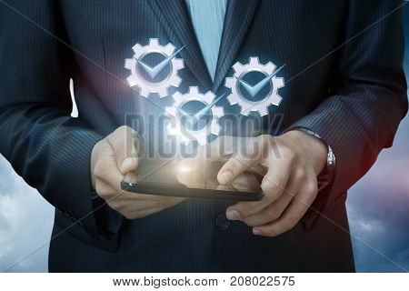 Businessman On Tablet Shows Icons Of A Job Well Done .