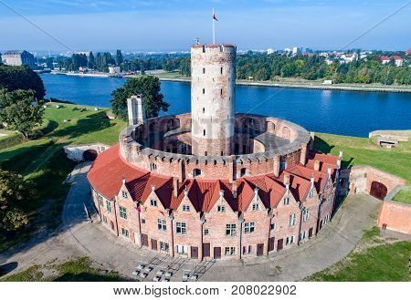 Medieval Wisloujscie Fortress with old lighthouse tower in port of Gdansk Poland A unique monument of the fortification works. Aerial view