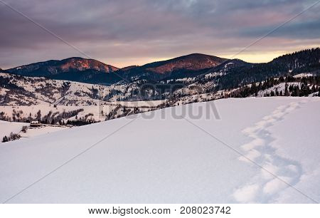 Footpath On Snowy Hillside In Mountains At Sunrise