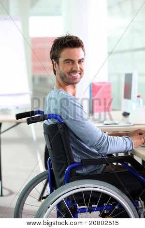 Young man smiling in wheelchair
