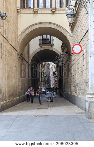 BARCELONA, SPAIN - MAY 10, 2017: It is the arched passage from the Placa de la Merce to the Gothic Quarter.