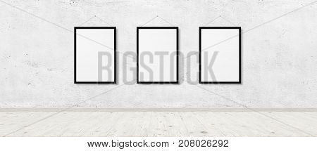 Photo of vintage room interior with three photo frames over white brick wall and wood floor background