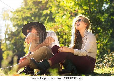 Two Friends Enjoying Autumn Day In The Park