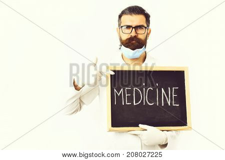 Bearded Caucasian Doctor Holding Syringe And Board With Medicine Inscription