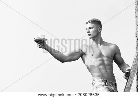 Man Holding Cup Of Coffee On Sky Background, Serious Face