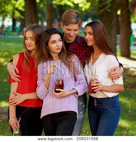 Jealousy and envy in friends relationship. One macho man dating with all women on the party. Seduction secrets, pickup, alpha male concept
