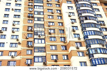 A horizontal image of the facade of a residential building.
