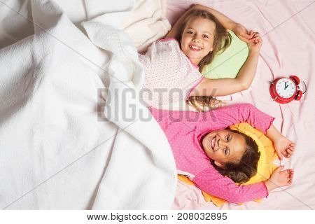 Schoolgirls Having Pajama Party. Children With Smiling Faces