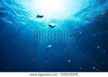 Sea underwater view with sun light. Beauty nature background