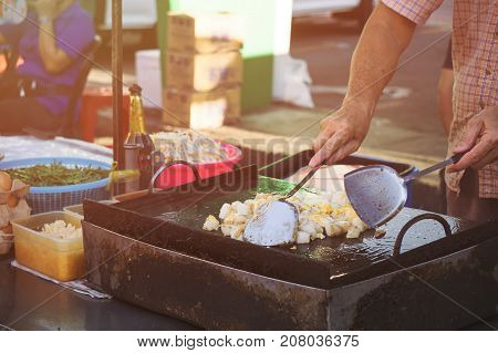 Man Cooking A Fried Radish Cake Also Known As Turnip Cake Or Lo Bak Go.