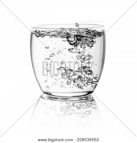 Glass with water isolated over white background