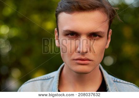 Angry aggressive man face. Problems in communication, quarrels and hatred, hard divorce concept