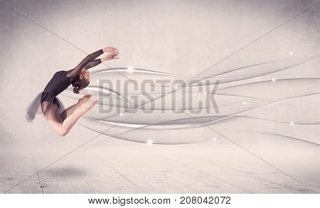 Ballet dancer performing modern dance with abstract lines concept on background