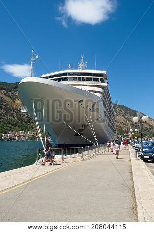 MONTENEGRO, KOTOR - AUGUST 13, 2017: View of the cruise ocean liner Silver Muse at the pier of the city of Kotor