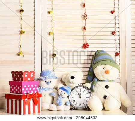 Snowmen, Teddy Bears And Present Boxes Near Alarm Clock