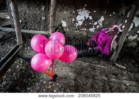 Balloons At The Background Of A Dead Girl